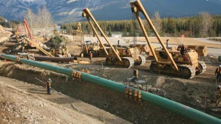 Kinder Morgan crew doing pipeline construction. Kinder Morgan today filed its formal application for