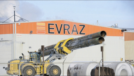 Large-diameter pipe is moved at Evraz Regina on Thursday. Layoff notices have been issued for 80 per